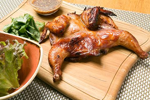 ひな鶏の漬け焼き スパイシータマリンドソース~ガイヤーン~